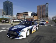 NASCAR Sprint Cup Series champion Brad Keselowski leads a parade of Ford Racing cars through the streets of Charlotte on the fourth and final day of the NASCAR Sprint Media Tour hosted by Charlotte Motor Speedway. (CMS/HHP Photo)