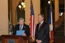 Governor Terry Branstad (l) reads the official State Proclamation for NASCAR Hall of Famer Rusty Wallace (r) during ceremonies in the  Capitol Rotunda (February 27, 2013)