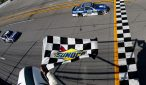 Dale Earnhardt Jr. takes the checkered flag at Talladega. Photo Credit: Jeff Zelevansky/NASCAR via Getty Images