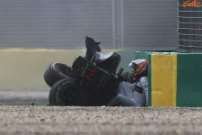 Fernando Alonso extracts himself from his destroyed McLaren Honda. Photo: Sutton-Images