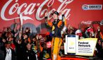 Martin Truex Jr. celebrates winning the Coca-Cola 600. Photo: Todd Warshaw/NASCAR via Getty Images