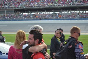 Jeremy Clements receives a hug from his Dad after a series career-best fourth place finish at Talladega, April 30, 2016 - Photo Credit: Jason Watson