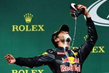 Daniel Ricciardo celebrates his podium finish by chugging champagne from his shoe. Photo: Mark Thompson/Getty Images