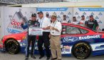 Greg Biffle poses in front of his car after scoring the pole at Daytona. Photo by Noel Lanier.
