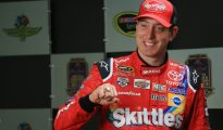 Kyle Busch shows off his ring for winning the Brickyard 400 to the media at the Indianapolis Motor Speedway. Photo: Daniel Shirey/Getty Images