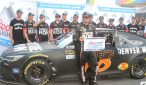 Martin Truex Jr. poses for pictures in front of his car after winning the pole at Pocono. Photo Credit: Tammyrae Benscoter