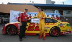 Joey Logano poses in front of his car after winning the pole for the Pure Michigan 400 at Michigan International Speedway. Photo: Sean Gardner/Getty Images