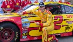 Joey Logano poses in front of his car after winning the pole for the Pure Michigan 400 at Michigan International Speedway.  Photo Credit: Tim Jarrold