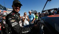Martin Truex Jr. applies the winners sticker to the side of his car following his victory in the Teenage Mutant Ninja Turtles 400 at Chicagoland Speedway. Photo: Jeff Zelevansky/NASCAR via Getty Images