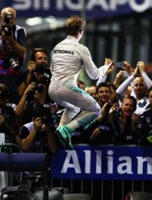 Nico Rosberg leaps in celebration of his dominant victory in the Singapore Grand Prix. Photo: Clive Mason/Getty Images