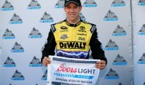 Matt Kenseth poses with the pole award flag after winning the pole for the Hollywood Casino 400 at Kansas Speedway. Photo: Matt Sullivan/Getty Images