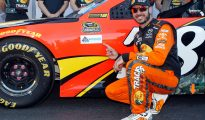 Martin Truex Jr. poses in front of his car after winning the pole for the Hellmann's 500 at Talladega Superspeedway. Photo: Brian Lawdermilk/Getty Images