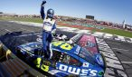 Jimmie Johnson celebrates on Sunday after becoming the first driver to win four Bank of America 500 NASCAR Sprint Cup Series races at Charlotte Motor Speedway. (CMS/HHP photo)