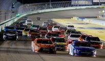 Elliott Sadler leads the field going into Turn 1 at Homestead-Miami Speedway following a bad restart by race leader Cole Whitt. Photo: Chris Trotman/Getty Images