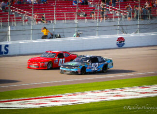 Harrison Rhodes Passes Joey Gase on the outside at Vegas in Xfinity Series. Photo by Rachel Myers for SpeedwayMedia.com