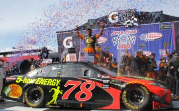 Martin Truex Jr. celebrates in Gatorade Victory Lane after winning at Auto Club Speedway. Photo by Rachel Myers for Speedway Media.