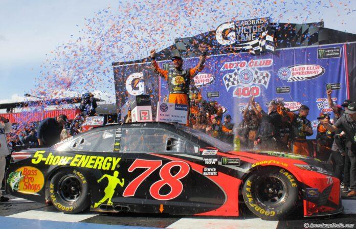Martin Truex Jr. celebrates in Gatorade Victory Lane after winning at Auto Club Speedway. Photo by Rachel Myers for Speedway Media.