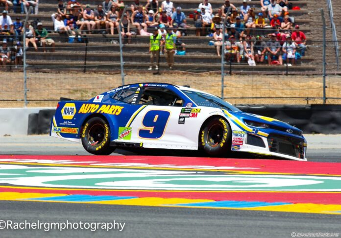 Chase Elliott hops the curb in Turn 7a at Sonoma Raceway. Photo by Rachel Myers for Speedway Media.