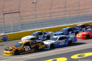 Daniel Hemric edges ahead of Ross Chastain on the restart. Photo by Rachel Myers for Speedway Media.