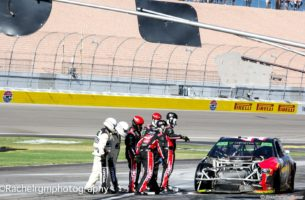 NASCAR Officials pull the pit crew of Kurt Busch away from the car as the red flag is displayed. Photo by Rachel Myers for Speedway Media.