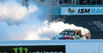 Kyle Busch celebrates with donuts and tire smoke in front of the fans at the new start-finish line at ISM Raceway after winning the Can-Am 500. Photo by Rachel Schuoler for Speedway Media.