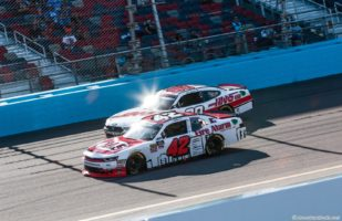 John Hunter Nemechek and Cole Custer battle for position in the Whelen Trusted to Perform 200 at ISM Raceway. Photo by Rachel Schuoler for Speedway Media.
