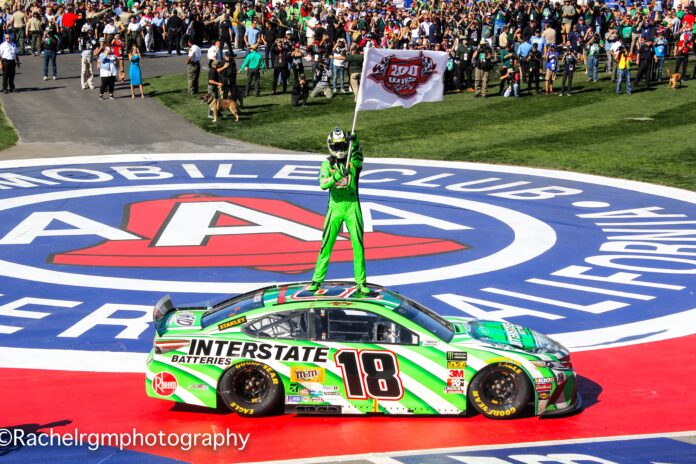 Kyle Busch waves a