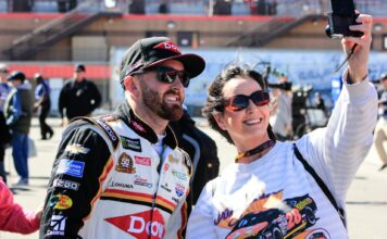 Austin Dillon poses for a selfie with a fan before going out for qualifying at Auto Club Speedway for the Auto Club 400. Photo by David Myers for Speedway Media.
