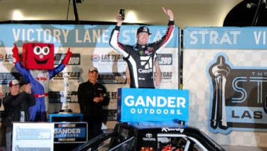 Kyle Busch celebrates with his NASCAR Gander Outdoors Truck Series team in victory lane at Las Vegas Motor Speedway. Photo by David Myers with SpeedwayMedia.com.