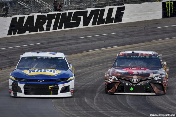 Kyle Busch looks to the inside of Chase Elliott at Martinsville. Photo by Christian Gardner for Speedway Media.