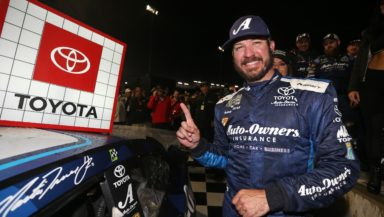 Martin Truex Jr. gets to place the winner's sticker on his car after claiming his first career short track victory at Richmond Raceway. Photo courtesy of Matt Sullivan with Getty Images.