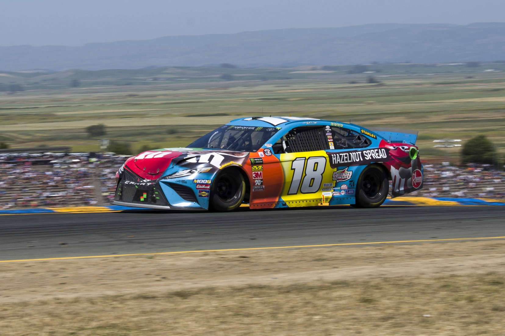 Kyle Busch closes the gap on teammate and leader Truex after front end damage from contact with Ryan Blaney. Photo courtesy of Patrick Sue-Chan for Speedway Media.