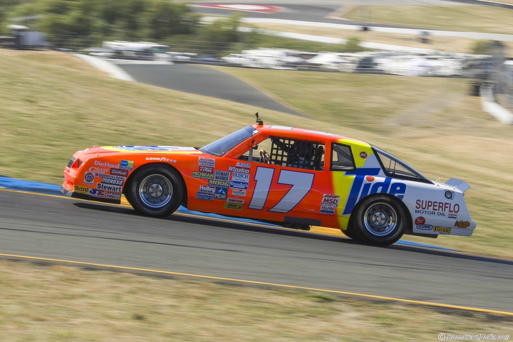"Darrell Waltrip drives around Sonoma Raceway in his original Daytona winning ""Tide Ride."" Photo courtesy of Patrick Sue-Chan for Speedway Media."