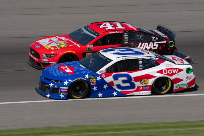Austin Dillon races to the inside of Daniel Suarez at Michigan International Speedway. Photo courtesy of Tim Jarrold for Speedway Media.