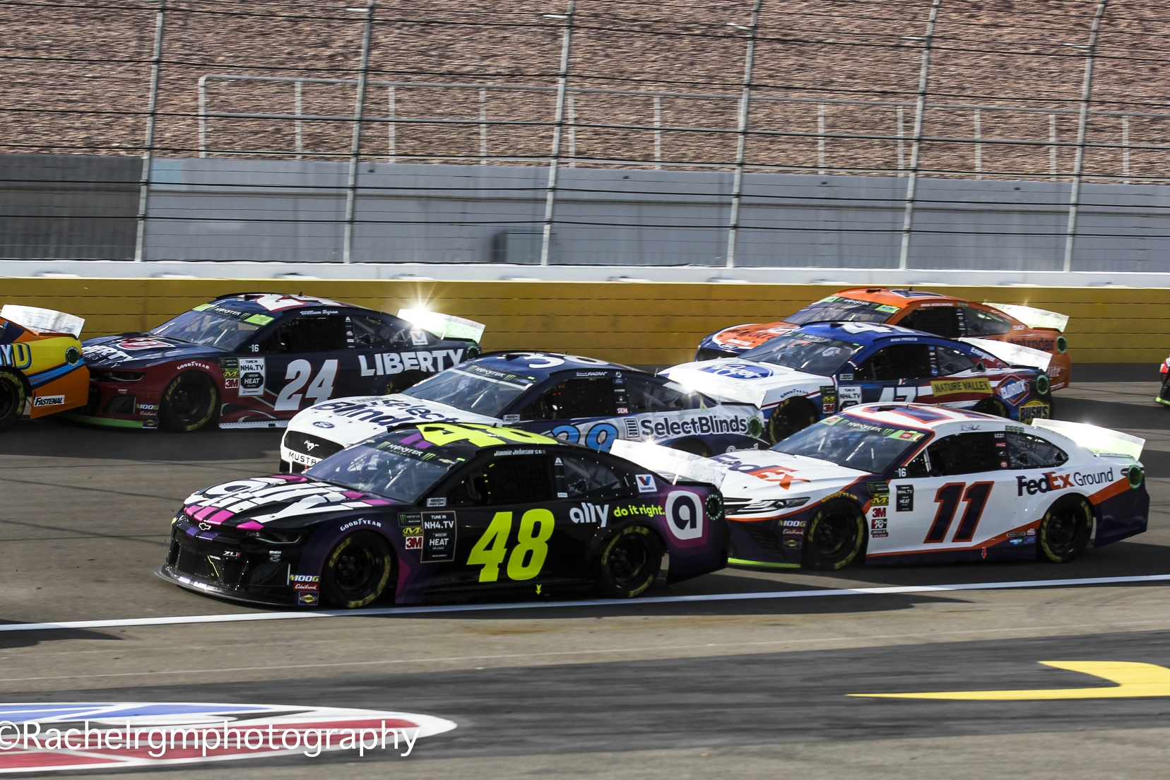 Jimmie Johnson and Denny Hamlin make it three-wide going into Turn 1 at Las Vegas Motor Speedway.