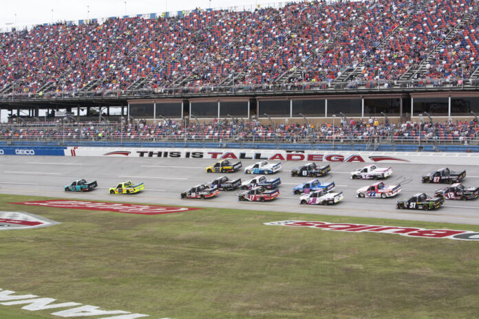 The NASCAR Truck Series races through the tri-oval at Talladega Superspeedway in the 2019 Sugarlands Shine 250. Photo courtesy of Stephanie McLaughlin with Speedway Media.