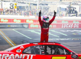 Justin Allgaier celebrates in front of the fans at ISM Raceway after breaking his winless drought and securing his spot into the Championship race. Photo courtesy of Rachel Schuoler for Speedway Media.
