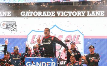 Stewart Friesen celebrates in the Gatorade Victory Lane after winning the 2019 Lucas Oil 150 at ISM Raceway. Photo courtesy of David Myers with Speedway Media.